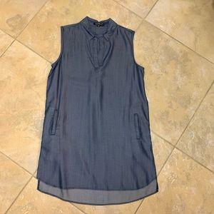Sleeveless collared denim dress with pockets